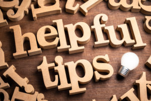 "wooden letters on table that spell ""helpful tips"""