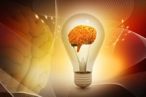 A light bulb in which the filament os replaced by a human brain.